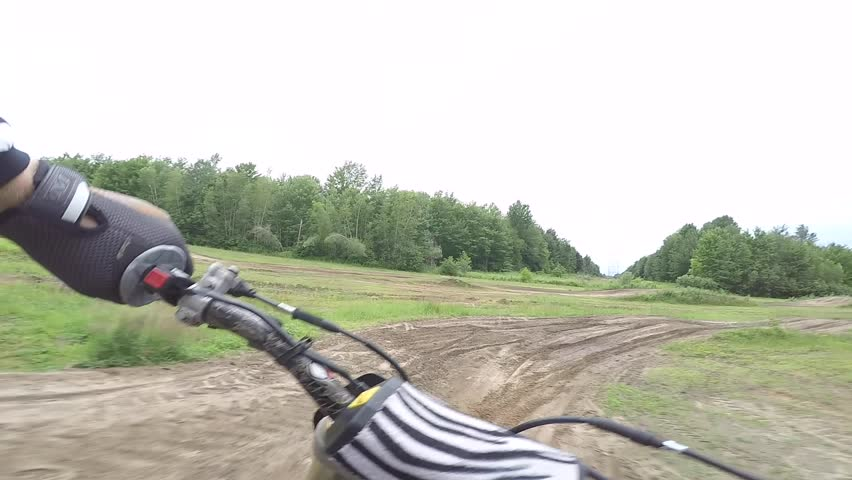 Motocross amazing view from saddle shows rider through whoop section gimbal   Shutterstock HD Video #1011356516