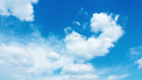 Seamless Loop Clouds, Beautiful white clouds soar across the screen in time lapse fashion over a deep blue background. Blue Sky, Flight over clouds, loop-able, cloudscape, day. FHD.