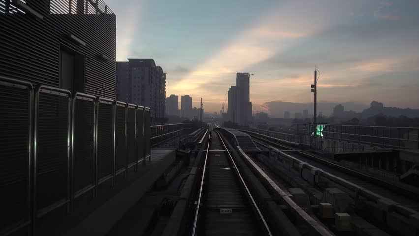 KUALA LUMPUR, MALAYSIA - 11 MAY, 2018 : Malaysia MRT (Mass Rapid Transit) train and railway during sunrise. MRT is a transportation for future generation and bring Malaysia as a developed country   Shutterstock HD Video #1011376526