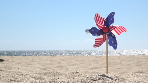 July 4th spinner with stars and stripes on the beach
