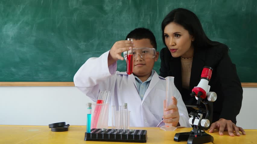 Young  asian student studying with his teacher in classroom | Shutterstock HD Video #1011398996
