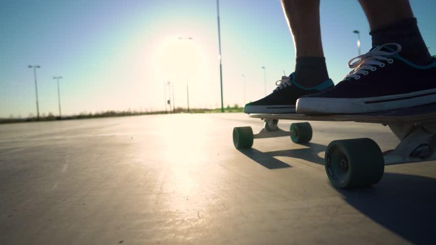 skateboarder legs skateboarding at city #1011403106