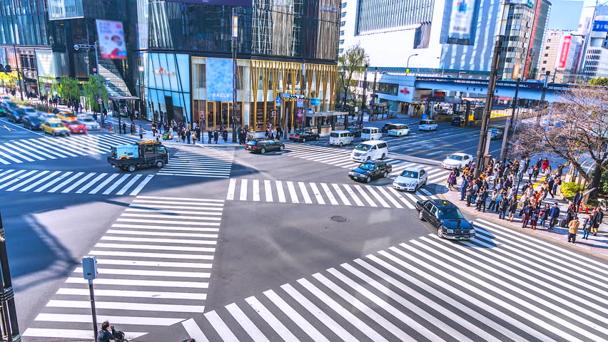 4K,Time lapse traffic and crowd people at ginza district intersection in Tokyo of Japan | Shutterstock HD Video #1011427616