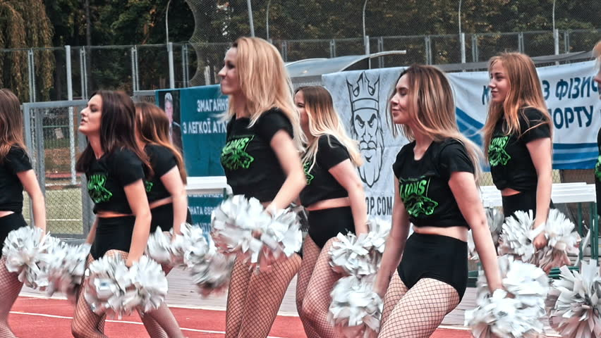 VINNITSA, UKRAINE - MAY 2018: Performance of beautiful young girls of cheerleader team. Team performance cheerleader on stadium