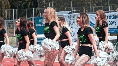 VINNITSA, UKRAINE - MAY 2018: Performance of beautiful young girls of cheerleader team. Team performance cheerleader on stadium