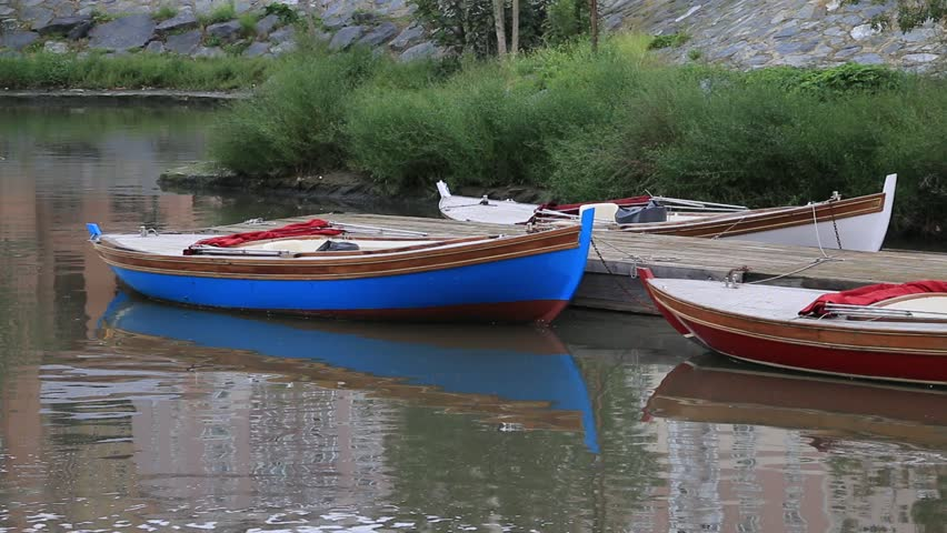 small wooden boats on the river