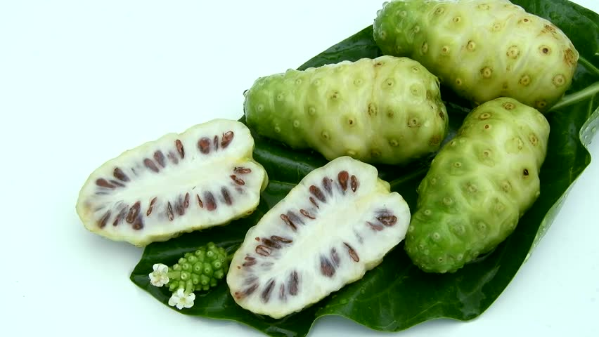 Top view fresh noni fruit in leaf on white background and poring water clips | Shutterstock HD Video #1011458156