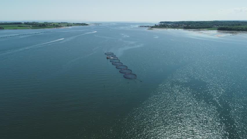 Drone view of fishing nets in Jutland, Denmark | Shutterstock HD Video #1011502346