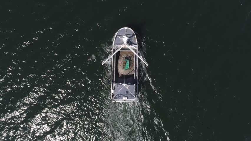 Drone flight over boat in Jutland, Denmark | Shutterstock HD Video #1011502376