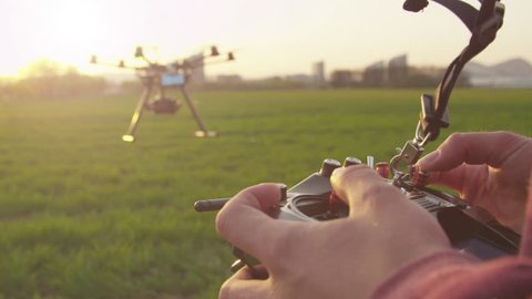 SLOW MOTION: Multicopter operator flying multicopter outdoors