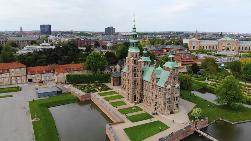 Aerial view of Rosenborg Castle (renaissance style palace) situated in The King's Garden (Kongens Have) - central Copenhagen, capital city of Denmark from above | Shutterstock HD Video #1011516236