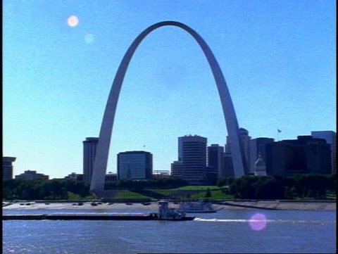 ST. LOUIS, 1999, St. Louis Arch, with skyline, Mississippi River, barges moving, medium shot