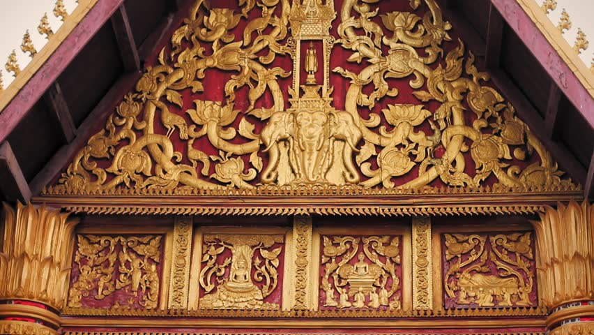 Chanthaburi Temple - Vientiane, Laos. Details of golden lotus, elephants and different ornamentation in the facades temple.