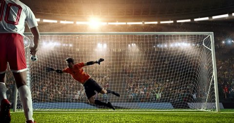 Soccer goalie catches a ball on a prefessional soccer stadium. Athlete wears unbranded sport clothes