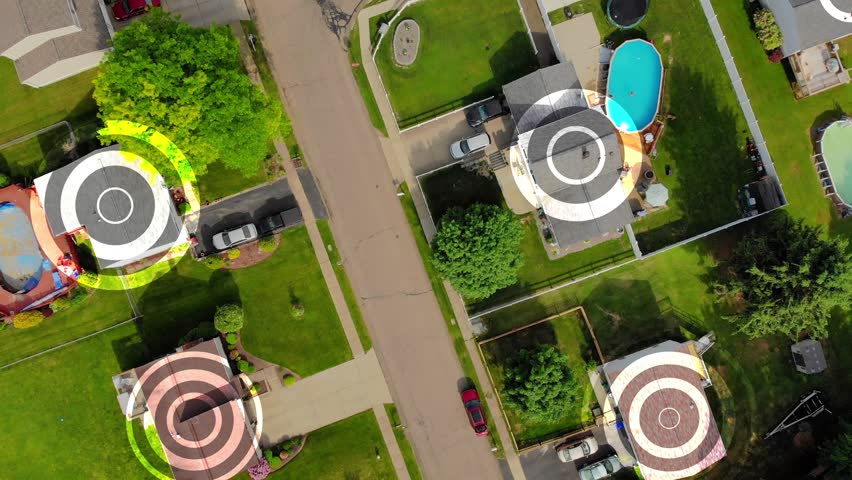 An aerial top down flyover view establishing shot of a typical Pennsylvania residential neighborhood with WiFi hotspot target markers over random homes. Pittsburgh suburbs.