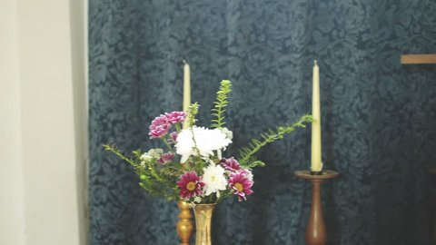 Church Wooden Cross Between Candles And Flowers