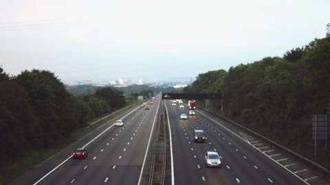Out of focus slow traffic on M5 Motorway B, Captured in Clapton-in-Gordano, England - Bright sky