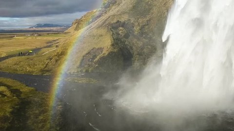 waterfall in the southern part of Iceland, just south of Eyjafjallajokull. Extraordinary spectacle, Skogafoss with a rainbow