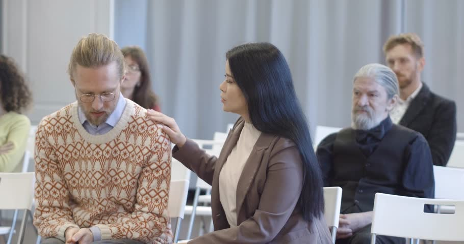 Young asian woman comfort member of their therapy group. Trying to give advice. | Shutterstock HD Video #1011679256