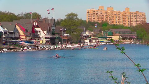 Philadelphia, PA / USA - May 2, 2018: Rowboat teams enjoy a beautiful day on Philadelphia's Schuylkill River in front of the city's iconic Boathouse Row