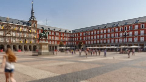 Hyper lapse exit in Plaza Mayor, Madrid, blurred unrecognizable people