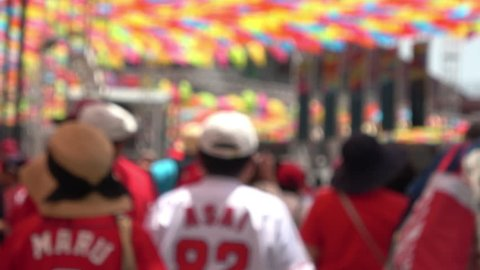 Blurred shot of the baseball fans walking to a ballpark, 4K, raw