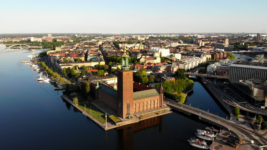 """Aerial view, panning in on the Stockholm City Hall """"Stadshuset"""" and its surroundings."""