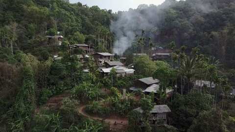 Hill tribe village hidden in the northern Thailand mountains view from drone.