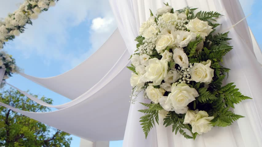 Beautiful static video 4k of the Jewish Hupa , wedding putdoor .Beautifully registered Huppa with a set of flowers.Closeup on a bouquet from roses.