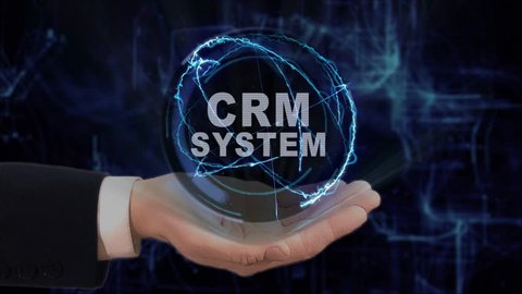 Painted hand shows concept hologram CRM system on his hand. Drawn man in business suit with future technology screen and modern cosmic background