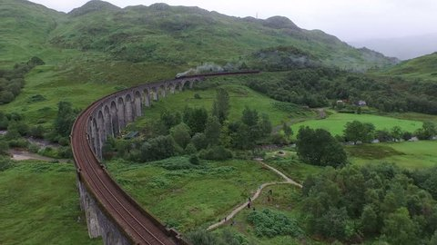Glenfinnan - May, 2016: Aerial view of the Jacobite crossing Glenfinnan Viaduct in Scotland