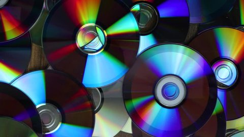 Going over a pile of CD and DVD discs, most of them copies