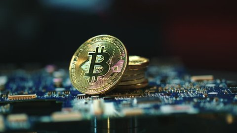 Modern bitcoin mining business. Stack of gold bitcoins on circuit board. Global blockchain technology. Cryptocurrency gpu farms equipment. Bitcoin mining concept