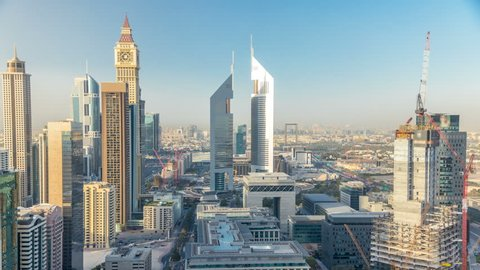 Skyline view of the buildings of Sheikh Zayed Road and DIFC timelapse in Dubai, UAE. Skyscrapers in financial centre aerial view from above before sunset