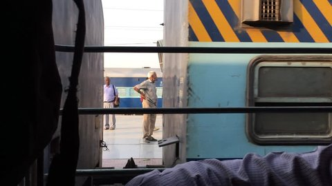 Indian railway blue color passenger train seen from the window.  Varanasi Banaras Benaras city/Uttar Pradesh state / India filmed on 14 May 2018