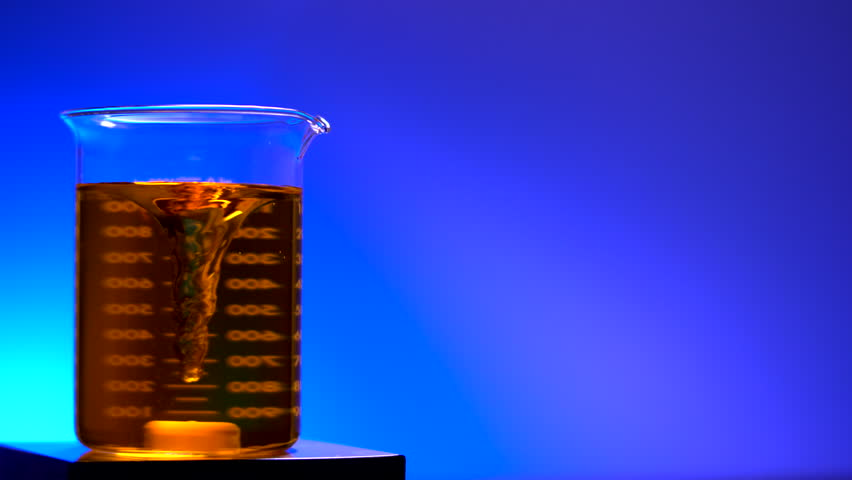 LABORATORY BEAKER BEING STIRRED.  4K, HLG close-up shot with negative space.   Shutterstock HD Video #1012044176