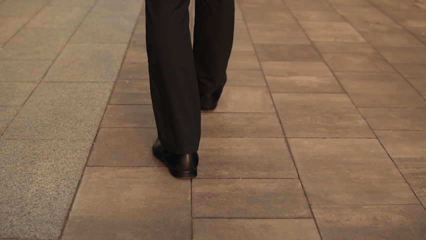 Back view businessman walking down the street. close up details man's legs and shoes | Shutterstock HD Video #1012093586