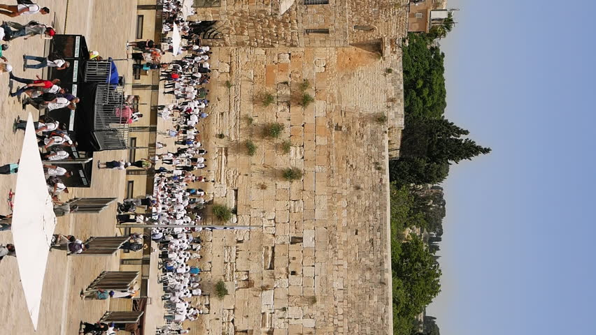Western Wall in Jerusalem also known as Wailing Wall or Kotel in Jerusalem. The Western Wall is sacred place for all jewish. People come to pray and put notes to the wall. Vertical format video.
