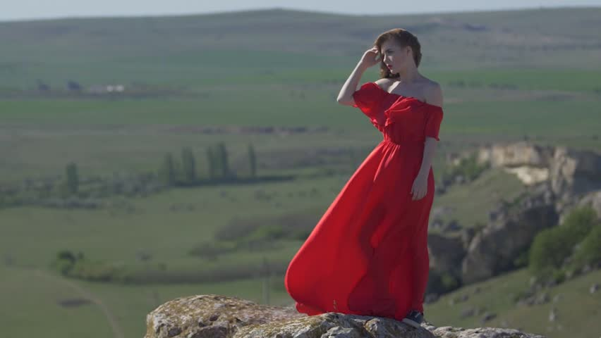 Portrait of a young woman in a long dress in full length | Shutterstock HD Video #1012141256