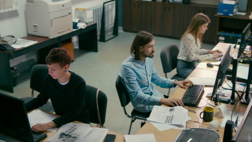 Young Employees are Working in the Open Space Office at Common Desk with Computers | Shutterstock HD Video #1012149926