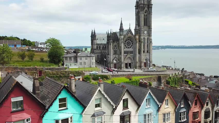 Aerial 4K Footage of colorful houses and St Colman's Cathedral in Cobh, Ireland | Shutterstock HD Video #1012175366