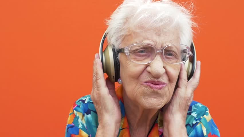 Grandmother funny moments on colored backgrounds | Shutterstock HD Video #1012186826