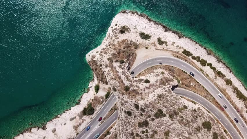 Aerial drone bird's eye view video of Tunel in Athens riviera seaside road known as hole of Karamanlis, Attica, Greece #1012188356