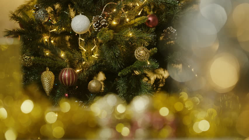Gift box with christmas light on abstract circular bokeh background. | Shutterstock HD Video #1012222946