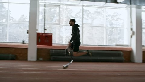 Tracking of determined adaptive runner with artificial fitness leg sprinting on indoor track