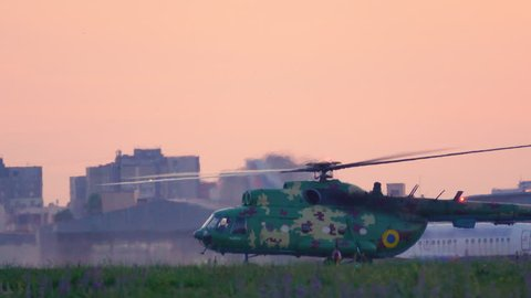 Military helicopter stands on the airfield before take off