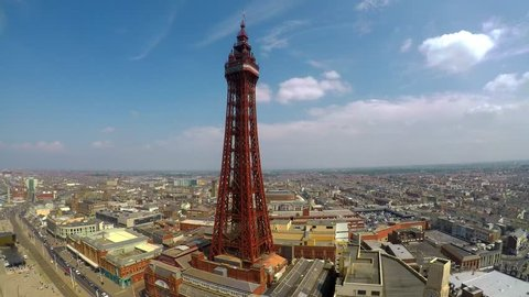 Stunning aerial footage, view of Blackpool Tower by the award winning Blackpool beach, A very popular seaside tourist location in England , United Kingdom, UK
