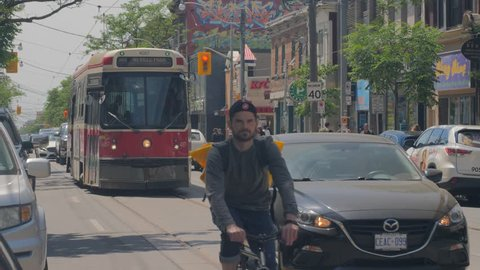 QUEEN STREET WEST, TORONTO, CANADA - CIRCA JUNE 2018: Various slow motion shots of the vibrant and culture filled neighbourhoods that encompass the fashion, arts and design districts of Toronto.