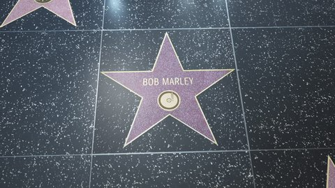 Hollywood, CA, USA - 05/03/18: Hollywood Walk of Fame Star with Bob Marley's name. Wide and CU Detail. For editorial purposes. Must get approval for 'commercial' use