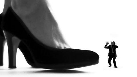 Female leg in high heels crushing small man, womens domination, silhouette